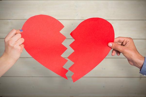 paper cut out of a broken heart